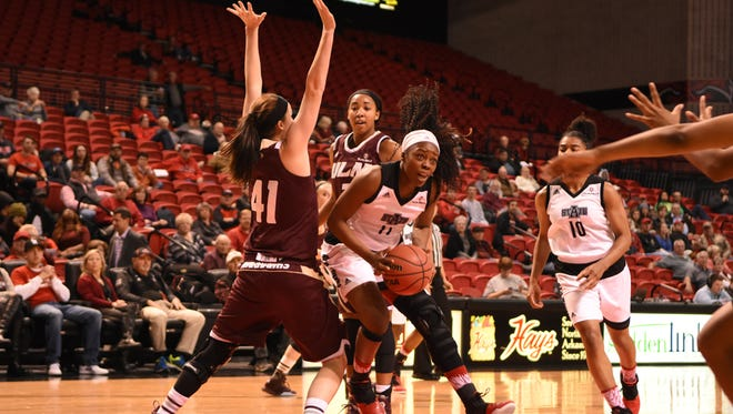 ULM's Dani Anderson (41) tries to defend against Arkansas State's Amanda Lawson (11) during Thursday's game.