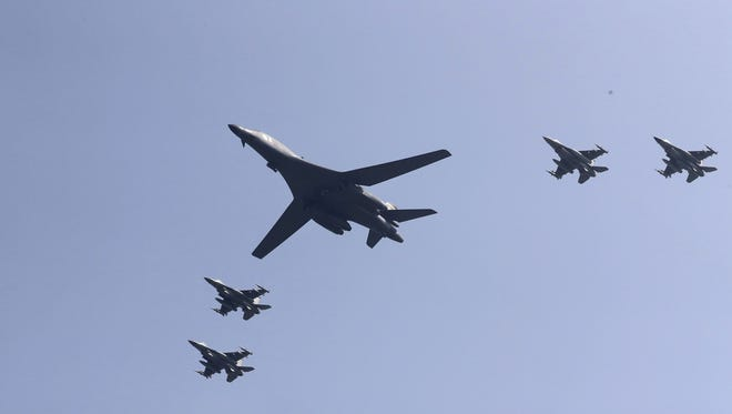 U.S. B-1 bomber, center, flies over Osan Air Base with U.S. jets in Pyeongtaek, South Korea, Tuesday, Sept. 13, 2016. The United States has flown nuclear-capable supersonic bombers over ally South Korea in a show of force meant to cow North Korea after its fifth nuclear test and also to settle rattled nerves in the South.