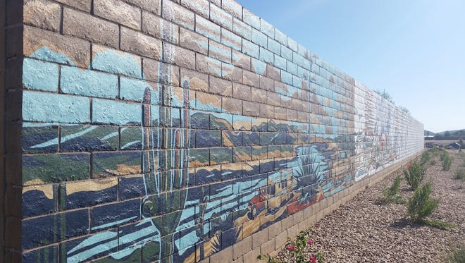 A San Diego-based artist created a 125-foot-long, 8-foot-high mural at the Meadows housing development at 91st Avenue and Deer Valley Road. It features six of the most recognizable locations in the city.