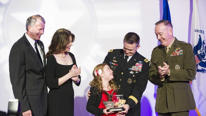 Lorelei McIntyre-Brewer, 10, receives a Military Child of the Year Award during a gala in Arlington, Va., April 14, 2016. The annual event that celebrates military children who demonstrate leadership, resilience and strength of character, as well as an ability to thrive while dealing with the challenges inherent in military life.