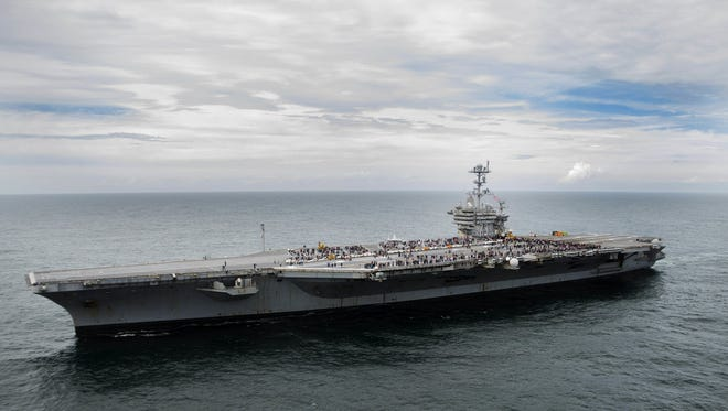 Carrier George Washington and the amphibious transport dock Mesa Verde put to sea Tuesday with Navy and Marine aircraft aboard and are headed to the Caribbean to provide relief from the storm if needed.