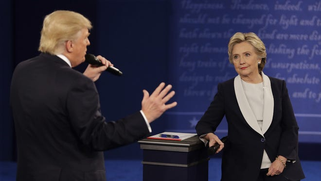Republican presidential nominee Donald Trump and Democratic presidential nominee Hillary Clinton speak during the second presidential debate at Washington University in St. Louis, Sunday, Oct. 9.