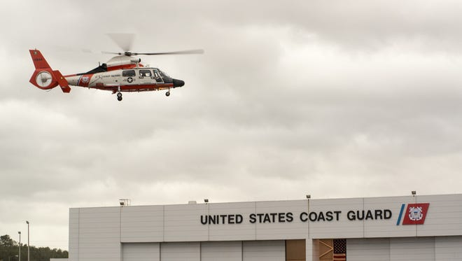 An Air Station Savannah aircrew takes off on a search-and-rescue case Oct. 8 from the air station. Coast Guard crews are utilizing Hunter Army Airfield as a forward operating base for Hurricane Matthew response efforts.