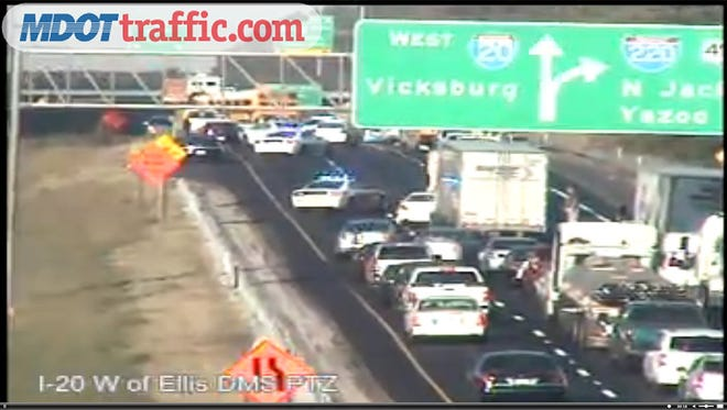 This screenshot shows traffic cam video of an crash on I-20 in Jackson.