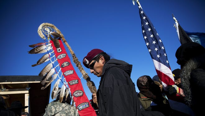 Native American veterans join an interfaith ceremony at the Oceti Sakowin camp where people have gathered to protest the Dakota Access oil pipeline in Cannon Ball, N.D., Sunday, Dec. 4.