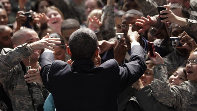 President Barack Obama greets members of the military at a rally during an unannounced visit at Bagram Air Field in Afghanistan, Friday, Dec. 3, 2010.