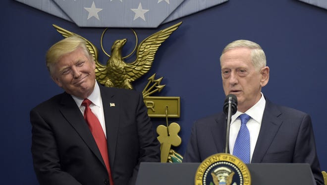 In this Jan. 27, 2017 photo, President Donald Trump, left, listens as Defense Secretary James Mattis, right, speaks at the Pentagon in Washington.