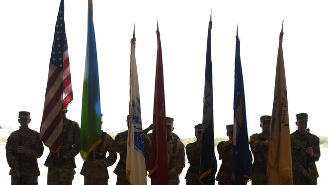 U.S. military members stand in a color guard formation during a change of command ceremony for Combined Joint Task Force-Horn of Africa April 13, 2016, at Camp Lemonnier, Djibouti. The ceremony officially transferred command of the task force from U.S. Army Maj. Gen. Mark Stammer to U.S. Army Brig. Gen. Kurt Sonntag.