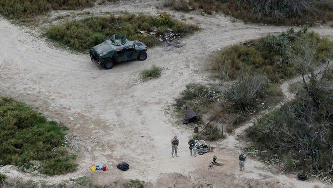 National Guardsmen patrol the Texas-Mexico border in Rio Grande City, Texas.