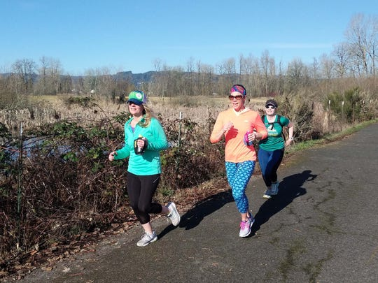 Licking Valley graduate Ashley Johnston Strausser, right, is one of five women participating in a 30 for 30 on Hwy 30 run to raise money for Charity: Water in Oregon on April 15.