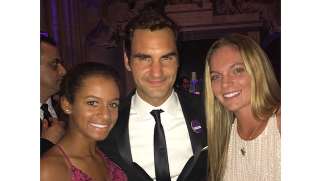 After finishing runner-up in the girls' doubles tournament at Wimbledon, Madeira's Caty McNally, right, and her doubles partner got a picture with Roger Federer at the Wimbledon Ball.