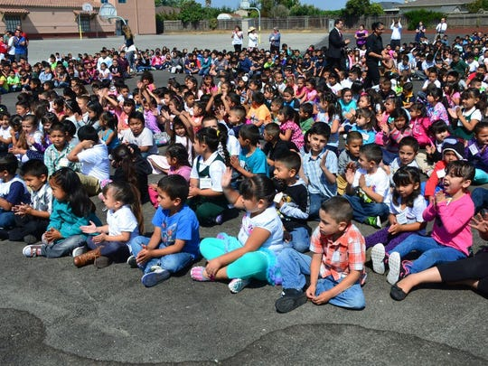 Students at Frank Paul School in Salinas await games and announcements on the first day of school Wednesday.