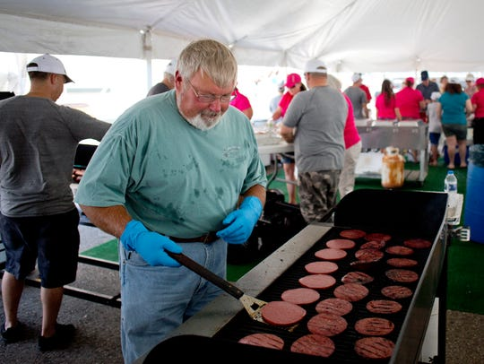 Dan Maley, of Emmett Township, works the grill flipping