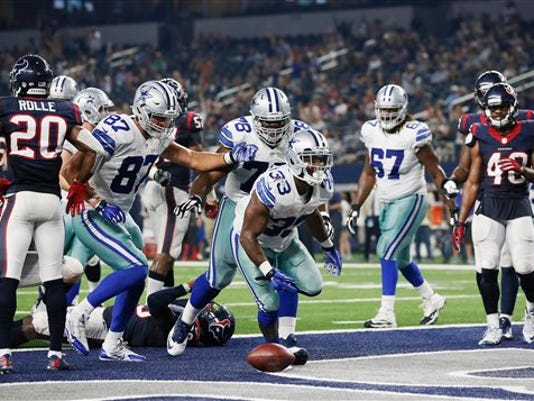 Dallas Cowboys running back Ben Malena (33) runs through the end zone after scoring a touchdown against the Houston Texans during the second half of a preseason NFL football game Thursday, Sept. 3, 2015, in Arlington, Texas.