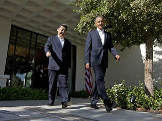 President Barack Obama walks with Chinese President