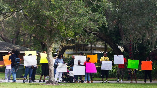Residents from the Dunbar community of Fort Myers protest outside Fort Myers Mayor Randall Henderson's home Saturday. The protests were held to address alleged abuse by the Fort Myers Police Department in the Dunbar community.