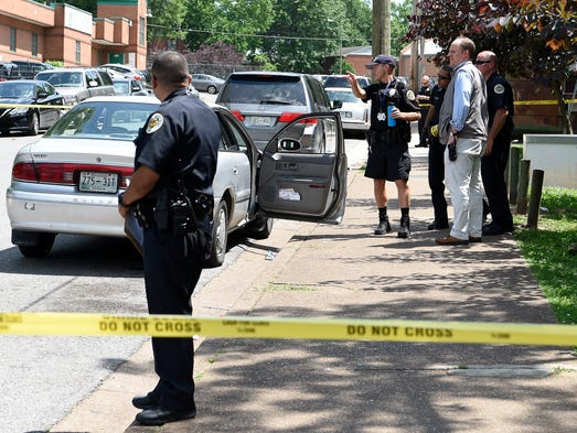 Metro Police officers investigate a shooting where