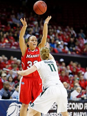 Mar 23, 2013; College Park, MD, USA; Marist Red Foxes guard Kristina Danella (33) makes a pass while defended by Michigan State Spartans forward Annalise Pickrel (11) during the first round of the 2013 NCAA women. Mandatory Credit: Mitch Stringer-USA TODAY Sports