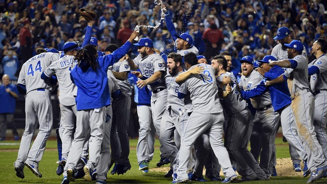 Kansas City Royals players celebrate on the field after defeating the New York Mets in game five of the World Series at Citi Field. The Royals won the World Series four games to one.
