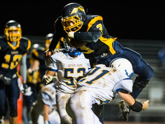 Elco's Kyle Knight leaps over Northern Lebanon's Noah