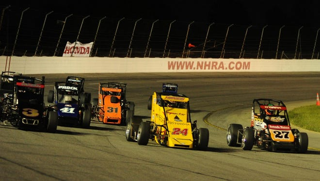 Tracy Hines 24, leads the USAC Midget field out of turn four during the Night Before the 500, Saturday May 24,  2014 at Lucas Oil Raceway.