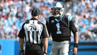 Carolina Panthers quarterback Cam Newton (1) talks to the official in the third quarter at Bank of America Stadium, Oct. 30, 2016.
