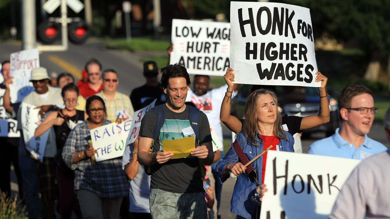 Activists demonstrate to support, and celebrate passage of, a Johnson County minimum wage increase in September 2015.