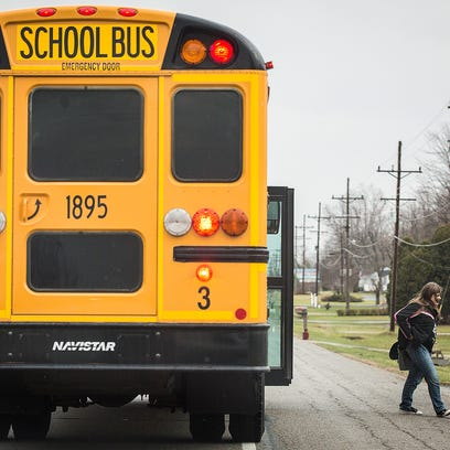 A Liberty Perry school bus drops of students on State