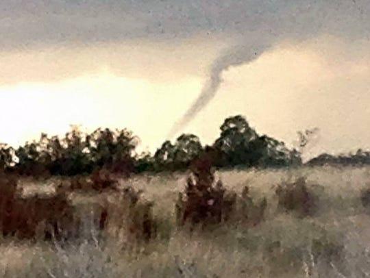 A funnel cloud seems close to touching down near Gallo