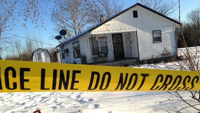 Police tape surrounds one of the crime scenes in Tyrone, Mo., Friday, Feb. 27, 2015. Authorities say multiple people were shot to death and one was wounded in attacks in the small southeastern Missouri town, and the suspected gunman was found dead from an apparent self-inflicted gunshot wound.