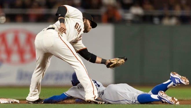 Giants shortstop Brandon Crawford tags Chris Taylor of the Dodgers in the eighth inning at AT&T Park in San Francisco.