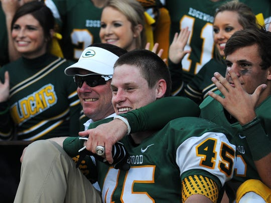 Edgewood coach Bobby Carr celebrates with Jesse Benton (45) after defeating Marengo Academy in the Class AA AISA State Championship game in Troy, Ala. on Friday November 21, 2014.
