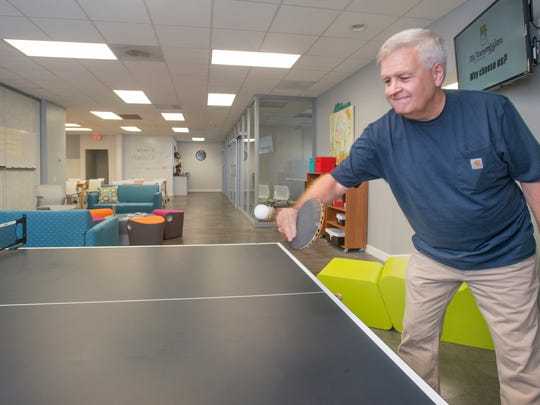 Community manager David Musselwhite plays ping pong at  Pensacola Socialdesk in Pensacola on Nov. 14.