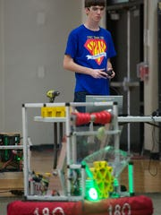 Tyler Woods, 18, the driver and SPAM team captain, tests their robot, 'Buzz Lightgear.'