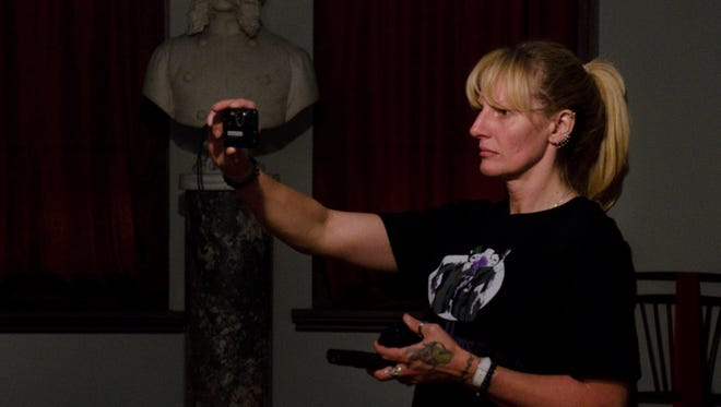 Jeanne Lee, of Egg Harbor Township, N.J., an investigator in training with South Jersey Ghost Research, takes photos while investigating in a room formerly used as a Masons meeting room at the Library Company of Burlington in Burlington City, N.J., on Oct. 5, 2012. The building dates back to 1864 and is believed to have several ghosts inhabiting it.