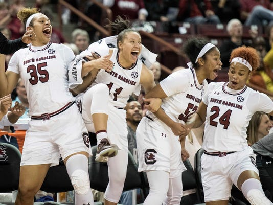 South Carolina forward Alexis Jennings (35), Lindsey Spann (11), Tyasha Harris (52) and Lele Grissett (24) celebrate a basket during the first half of an NCAA college basketball game against Alabama State on Friday, Nov. 10, 2017, in Columbia, S.C. (AP Photo/Sean Rayford)