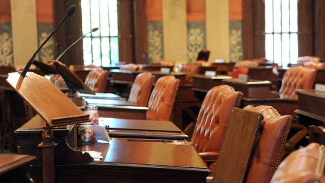 All 127 of the desks on the House of Representatives floor were refinished over the summer.
