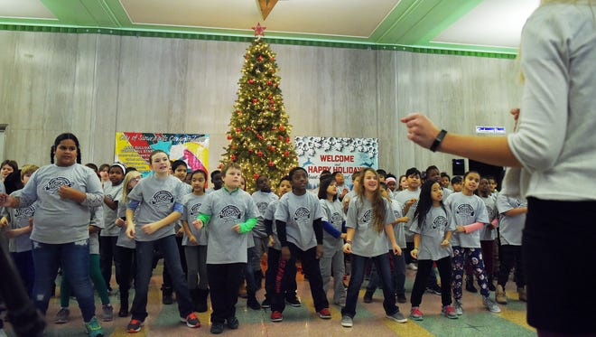 About a hundred fourth grade students from Anne Sullivan Elementary School perform under the direction of music teacher, Jaclyn Lange at City Hall in downtown Sioux Falls during the 2016 Annual Holiday Music Program.