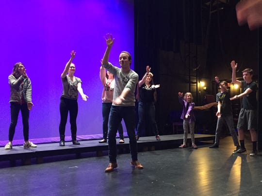 """Aaron Crosby, guest artist for the Spotlight Stage theatrical program at Wayne Theatre, guides students through a morning warm-up of physical exercises at Wayne Theatre on Saturday, Feb. 25, 2017. The young actors present their student showcase, """"Snow White and the Prince"""" March 4-5 at Wayne Theatre."""