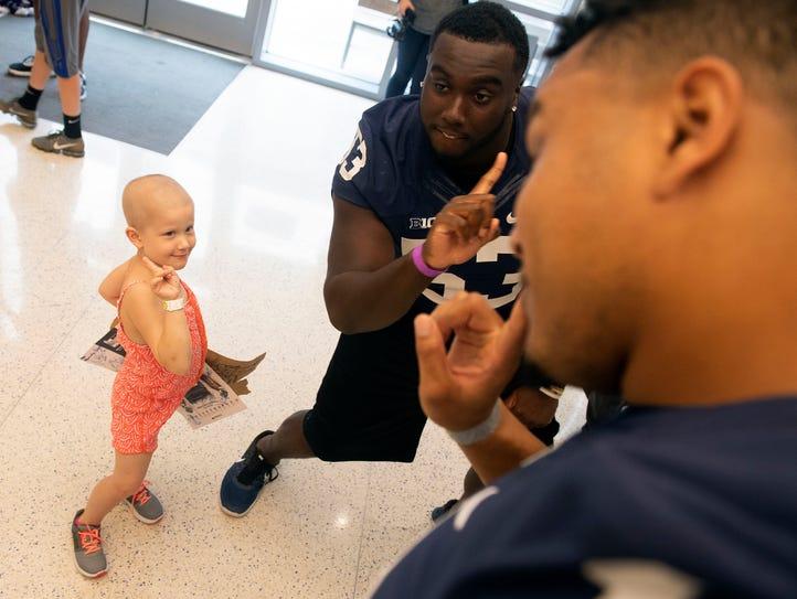 Devin Pulaski, 5, jokes around with Penn State players,