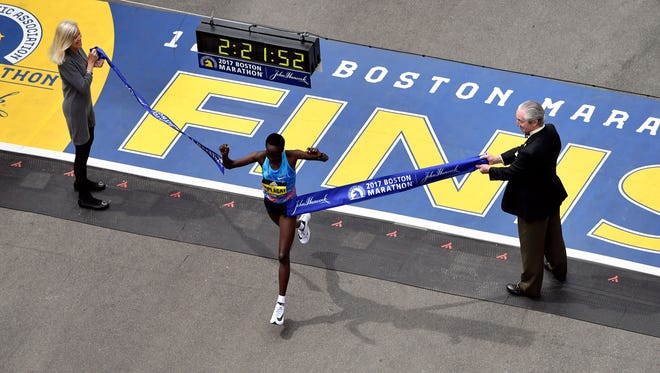 Edna Kiplagat crosses the finish line of the 2017 Boston Marathon winning the women's division.