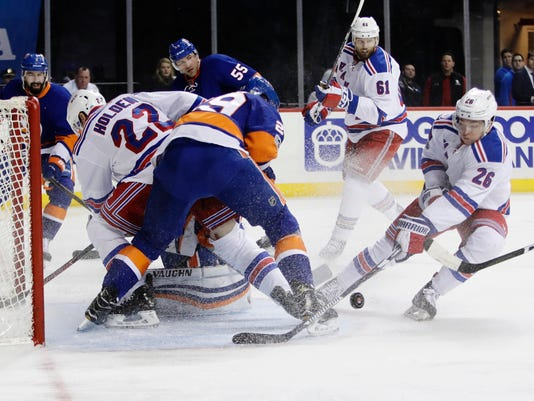 New York Rangers' Jimmy Vesey (26) has his shot deflected during the first period of the team's NHL hockey game against the New York Islanders on Thursday, Feb. 16, 2017, in New York. (AP Photo/Frank Franklin II)