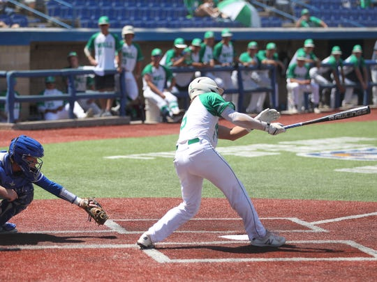 Wall High School's Tanner Seider swings at a pitch