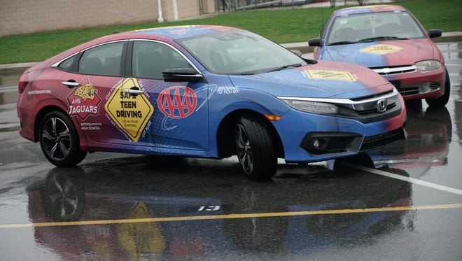 Selected students at Appoquinimink High School got their cars wrapped by Carvertise with safe teen driving messages in a pilot program being launched by AAA Mid-Atlantic.