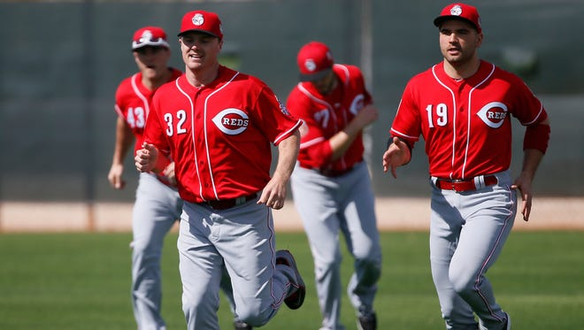 Cincinnati Reds right fielder Jay Bruce (32), left, and Cincinnati Reds first baseman Joey Votto (19), right, jog before workouts at Cincinnati Reds spring training, Tuesday, Feb. 23, 2016, in Goodyear, Arizona.