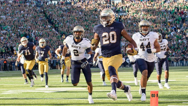 Notre Dame running back C.J. Prosise runs for a touchdown against Navy last season with a full crowd in the background. Another full crowd is expected when Nevada visits Notre Dame Stadium on Saturday.