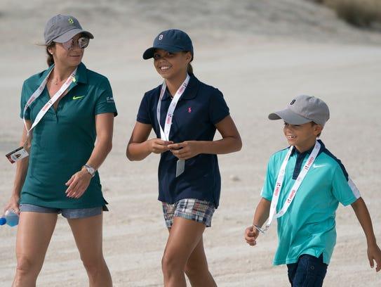 Tiger Woods' girlfriend, Erica Herman, left, walks