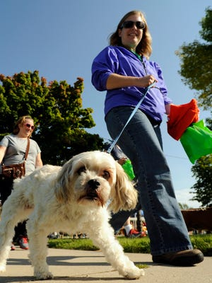 In this file photo, dogs and their owners participate in a Walk For Kindness charity in 2014 at the Lakeshore Humane Society in Manitowoc.