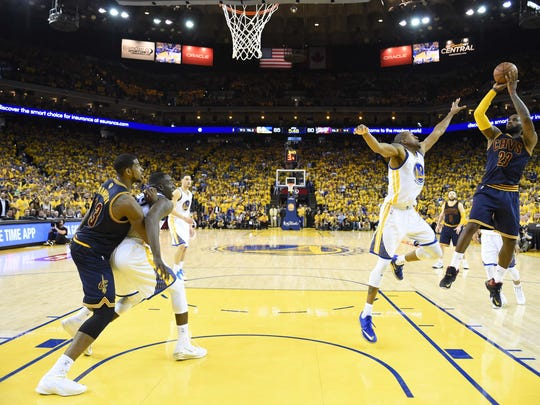 Jun 14, 2015; Oakland, CA, USA; Cleveland Cavaliers forward LeBron James (23) shoots the ball over Golden State Warriors guard Andre Iguodala (9) during the fourth quarter in game five of the NBA Finals at Oracle Arena. Mandatory Credit: Bob Donnan-USA TODAY Sports