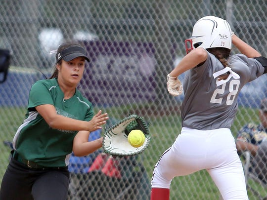 Nalani Moranaka, of the Oregon Titans Demarini, catches Allison Vincent, of the Marucci Patriots, at first base during their 2015 16U ASA/USA Softball National Championship game on Wednesday, July 22, 2015, in Salem, Oregon.
